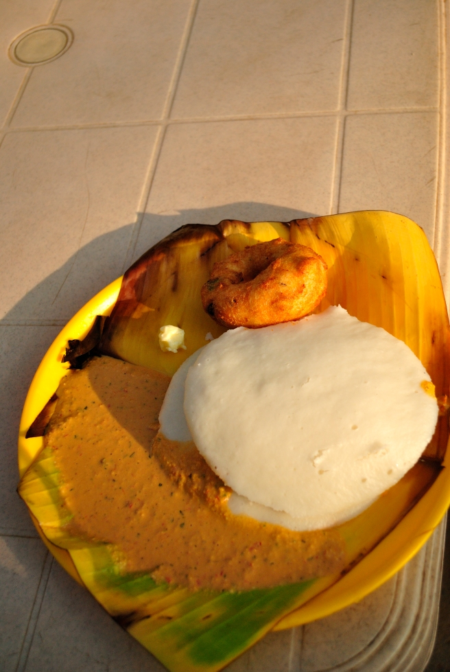 Piping hot Tatte (South Indian for plate) Idlis and crisp golden vadas at the famous Shree Renukamba hotel.