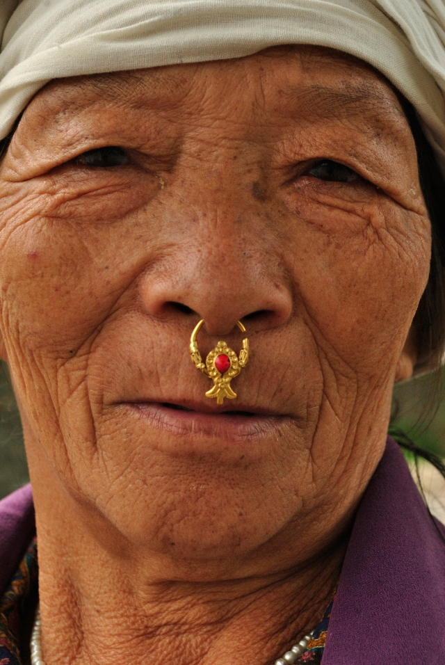 I was extremely fascinated with her nose ring. As she walked past us with her little grandson, i asked her if i could take a picture. She smiled shyly, but managed to keep her face neutral while i shot.