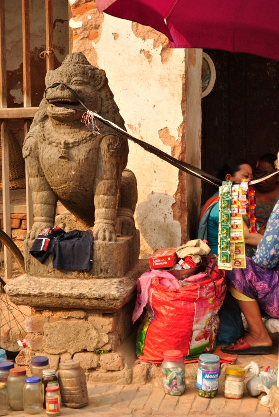 Patan Darbar Square, Kathmandu. Darbar Squares are massive, open spaces with temples, palaces and civilian residences co-existing next to each other. Patan Darbar Square is five centuries old an is the perfect example of traditions and modern-day living coming together.  This poor lion, however, is not a happy creature what with his majesty being abused by a shameless display of ghutkas.