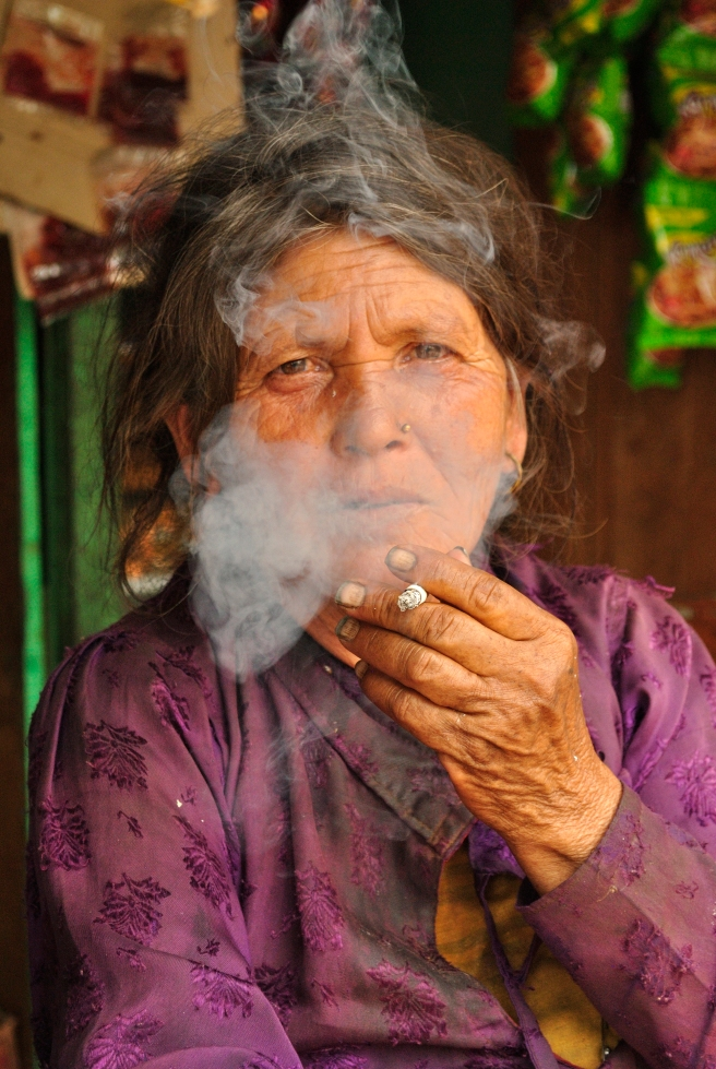 Since Nepal is known for being a 'Hare Rama Hare Krishna' destination, it seemed fitting to make this the opening shot for my posts on Nepal. This is the entire country in a single frame. The woman, however, is smoking a regular cigarette.