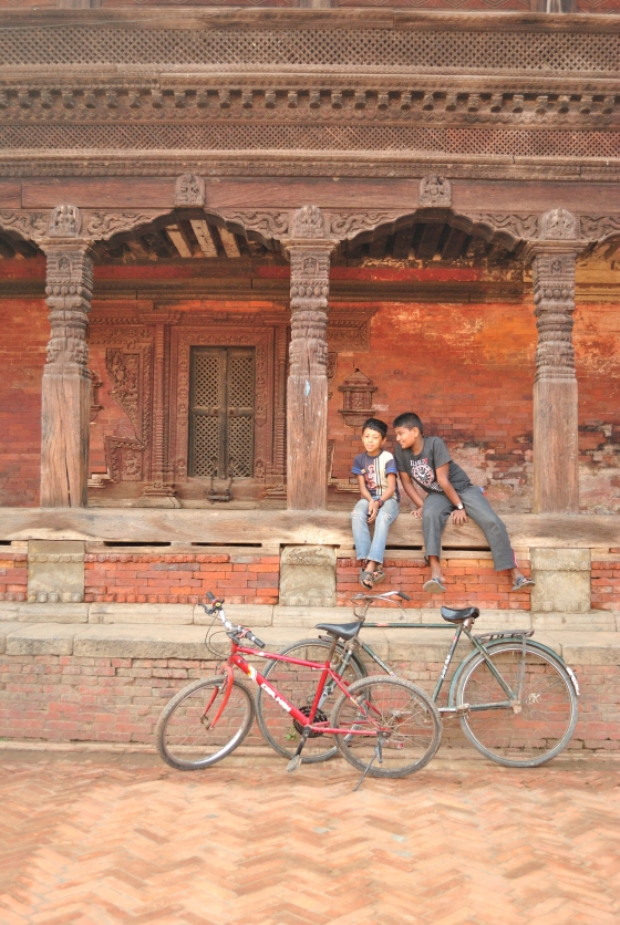 Two boys and a commentary. At the main square of Bhaktapur Darbar square, a UNESCO world heritage site.