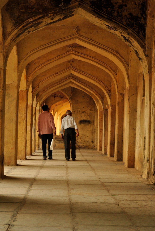 Mughal architecture is incomplete without symmetrical archways. So is my set of photographs! There's something almost poetic in framing a picture with arches and having someone walk through it.